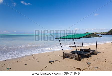 Tables And Chair On Beach Covered In Sand