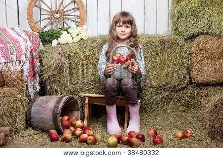 Portrait Of Girl Villager With  Basket Apples In Hayloft