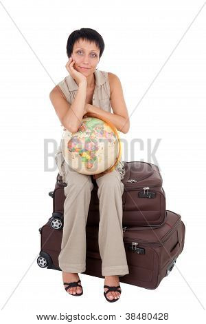 Young Tourist Woman Sits On The  Brown Traveling Suitcase With Globe Isolated