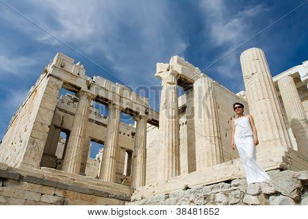 Woman Near Propylaea Columns Acropolis Athens Greece On Sky Background