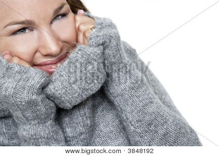 Smiling Girl In A Warm Sweater