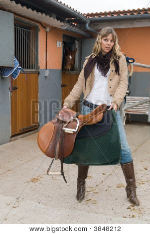 Woman Working In An Stable