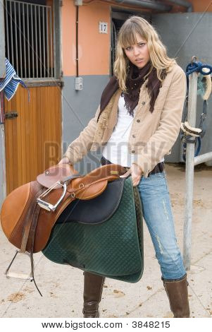 Woman With Horse And Jeans
