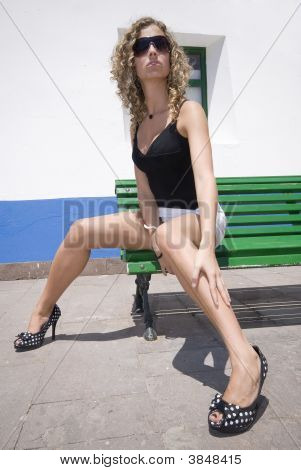 Sexy Girl In Miniskirt Sitting In The Street