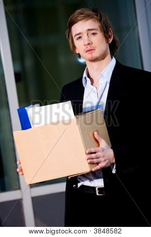 Unemployed Young Manager Leaving Business Center In Megalopolis