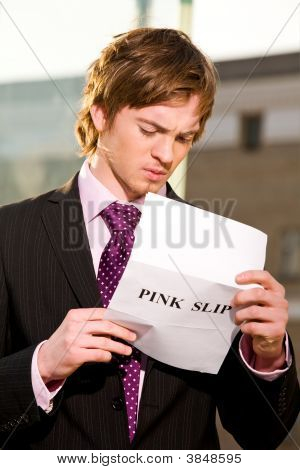 Manager Reading A Job Termination Notice Pink Slip