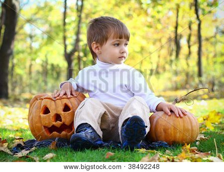 Little Boy With Two Helloween Pumpkins