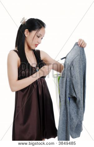 Young Oriental Woman Checking A Sales Tag