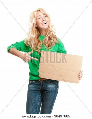 Beautiful And Happy Young Woman Holding Empty Piece Of Cardboard.