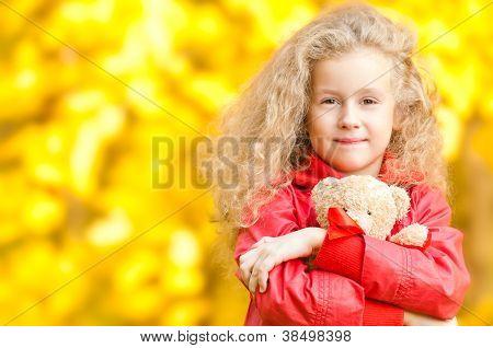 Beautiful Little Girl With Teddy Bear