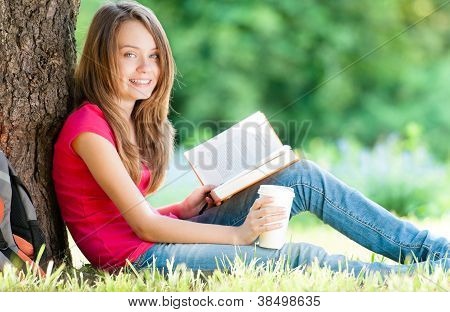 Happy Young Student Girl With Book