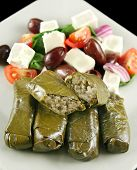 picture of greek food  - Greek dolmades wrapped with vine leaves and rice with salad - JPG
