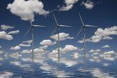 stock photo of wind-turbine  - Wind turbines in blue sky with water - JPG