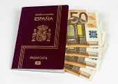 stock photo of spanish money  - Spanish Passport with 50 curency euro on white background - JPG