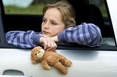 pic of pain-tree  - Little sad girl is in the car - JPG