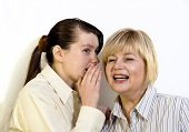 foto of chatterbox  - Two women gossiping and discussing hot news - JPG