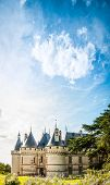 stock photo of chateau  - Ancient castle with fairy tale towers blue sky with clouds in background - JPG