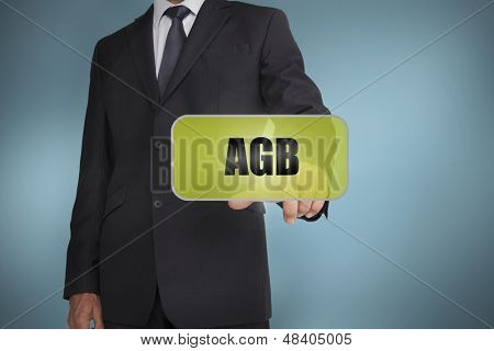 Businessman selecting green label with agb written on it on blue background