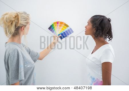 Housemates picking color for blank wall in their new home