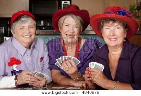 Ladies Wearing Red Hats Playing Cards