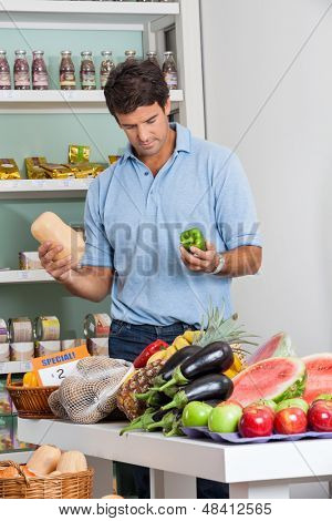 Mid adult man shopping vegetables in supermarket