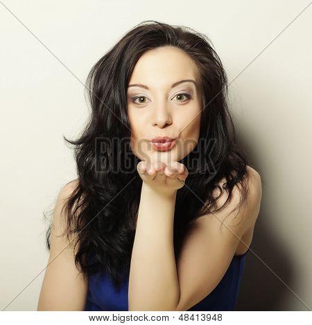 Beautiful girl sending air kiss