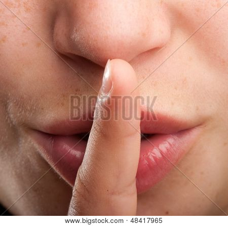 silence gesture close up