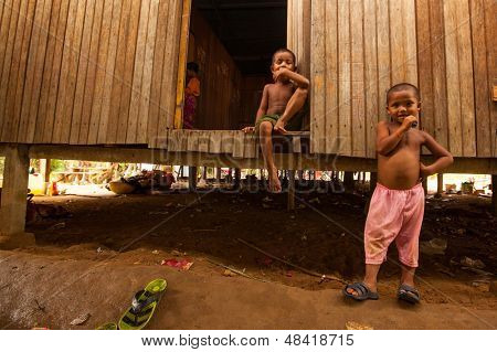 BERDUT, MALAYSIA - APR 8: Unidentified children Orang Asli in his village on Apr 8, 2013 in Berdut, Malaysia. More than 76% of all Orang Asli live below the poverty line, life expectancy -53 years old