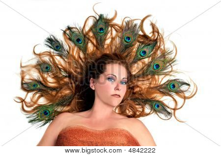 Redhead With Peacock Feathers In Her Hair On White Background