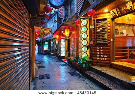 JIUFEN, TAIWAN - JANUARY 17: A shoplined alleyway January 17, 2013 in Jiufen, TW.  A gold mining town developed under Japanese rule, the city now attracts visitors for its nostalgic scenery.