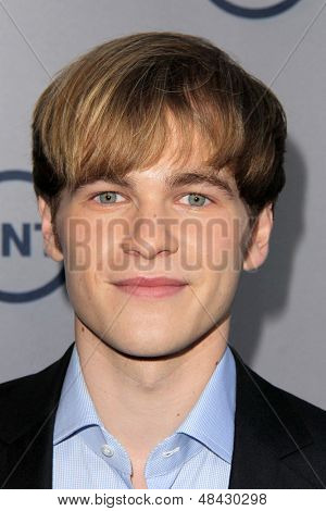 LOS ANGELES - JUL 24:  Graham Patrick Martin arrives at TNT's 25th Anniversary Party at the Beverly Hilton Hotel on July 24, 2013 in Beverly Hills, CA