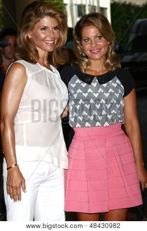 LOS ANGELES - JUL 24:  Lori Loughlin, Candace Cameron Bure arrives at  the Hallmark Channel Summer TCA event at the Beverly Hilton Hotel on July 24, 2013 in Beverly Hills, CA