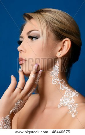 The beautiful woman with bodyart on hands
