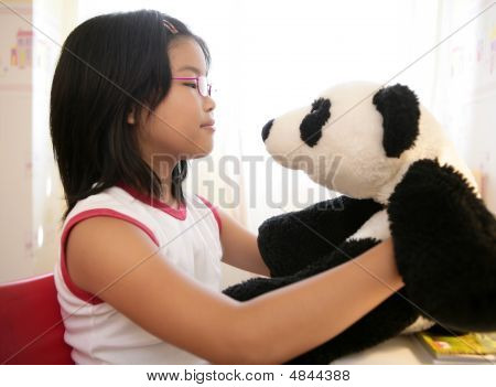 Asian Girl With Her Panda Teddy Bear