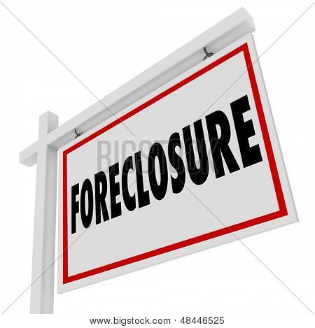 Foreclosure word on a home for sale real estate sign to illustrate failure to pay mortgage and default on a loan and the house being repossessed or reclaimed for non-payment or failure to pay