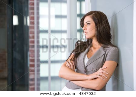 Business Woman Arms Crossed In A Modern Office