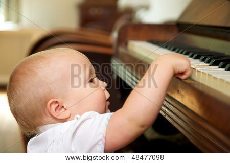 Cute Baby Playing On Piano