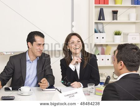 Man Explaining About His Profile To Business Managers At A Job Interview