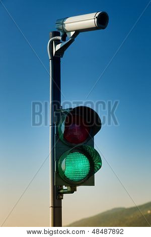 Green On Traffic Light With Security Camera
