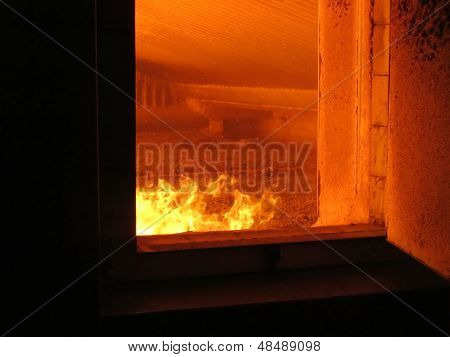 Fire The Combustion Of Biomass In The Form Of Pellets In The Boiler Stoker Coal, Visible Through The