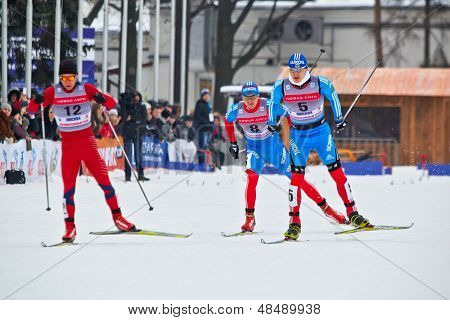 MOSCOW - FEB 9: Group of skiers during FIS Continental Cup ski racing in category of city-event, Feb 9, 2013, Moscow Russia. Track is constructed along central avenue at All-Russian Exhibition Center.