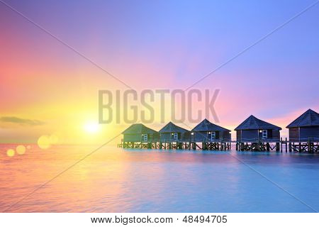 Sunset on Maldives island, water villas resort, Lhaviyani atoll