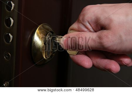 Someone opens door key close-up