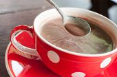picture of chocolate spoon  - Hot chocolate in a glass of red