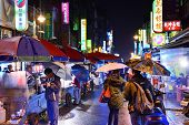 TAIPEI, TAIWAN - JANUARY 12: Pedestrians at a night Market at Guangzhou Street January 12, 2013 in T