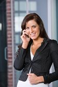 Business Woman On A Cell Phone In Modern Office