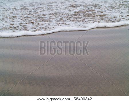 Ocean Foam At The Water's Edge