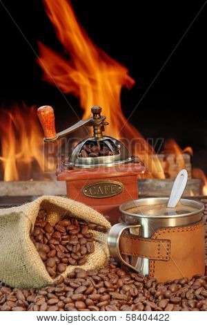 Stainless Steel Coffee Mug And Old Grinder With Beans