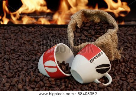 Two Cups Of Espresso And Coffee Beans On A Background Of Fire