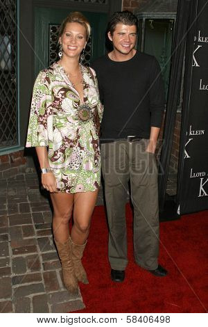 LOS ANGELES - NOVEMBER 14: Andrew Newton-Lee and guest at the opening party for the Lloyd Klein Flagship Store at Lloyd Klein Flagship Store on November 14, 2006 in Los Angeles, CA.